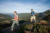 Young woman and man hiking near Donner Pass, CA.