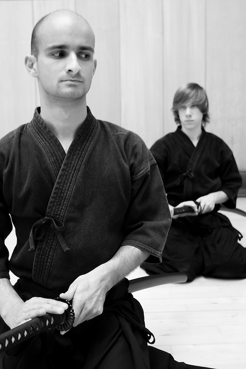 Two Iaido practicioners demonstrate the kata Ushiro, in which there is a response to a threat from behind