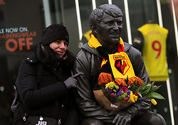 Fans lay flowers at the Graham Taylor statue outside of Vicarage Road just after the 2 year anniversary of his passing