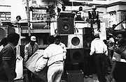 A group of people moving speakers, constructing a sound system Notting Hill, Carnival, London, UK, 1983.
