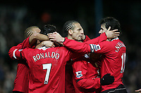 Photo: Lee Earle.<br /> Portsmouth v Manchester United. The Barclays Premiership. 11/02/2006. United players congratulate Cristiano Ronaldo after he scored their third goal.