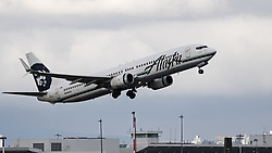 October 30, 2018 - Richmond, British Columbia, Canada - An Alaska Airlines Boeing 737-900 (N319AS) single-aisle narrow-body jet airliner takes off from Vancouver International Airport. (Credit Image: © Bayne Stanley/ZUMA Wire)