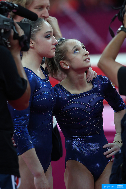 Aliya Mustafina, Russia, and team mate Victoria Komova, Russia, after the Floor Routine during the Women's Individual All-Around competition at North Greenwich Arena, during the London 2012 Olympic games. London, UK. 2nd August 2012. Photo Tim Clayton