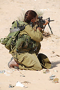 Female Israeli infantry soldiers training in the desert