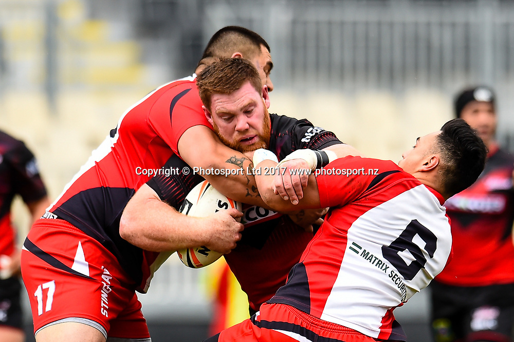 Alex Todd of the Canterbury Bulls is tackled by Kruz Tupou  and William Stowers of the Counties Manukau Stingrays during the NZRL Premiership, Round1 Rugby League match, Cnaterbury Bulls V Counties Manukau Stingrays, AMI Stadium, Christchurch, New Zealand, 17th September 2017. Copyright photo: John Davidson / www.photosport.nz