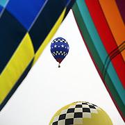 USA pilot Rhett Heartsill, takes to the skies around rural Michigan near Battle Creek during the World Hot Air Ballooning Championships. Battle Creek, Michigan, USA. 19th August 2012. Photo Tim Clayton