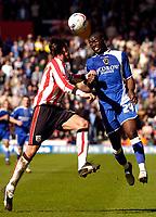 Photo: Alan Crowhurst.<br />Southampton v Cardiff City. Coca Cola Championship. 01/04/2006. Cardiff's Guylain Ndumbu-Nsungu (R) outjumps Claus Lundekvam.