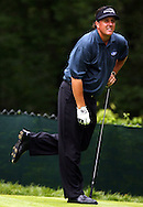 Phil Mickelson of the US reacts to his tee shot on the fifteenth hole during the first day of the US Open Golf Championship at Winged Foot Golf Club in Mamaroneck, New York Thursday, 15 June 2006.