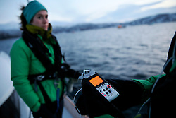 NORWAY TROMSO 5DEC15 - Greenpeace campaigner Larissa Baeumer of Germany during whale observations with a hydrophone in Kvalsoya Sound near the arctic city of Tromso.<br /> <br /> jre/Photo by Jiri Rezac / Greenpeace<br /> <br /> © Jiri Rezac 2015