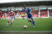 Doncaster Rovers No7 Gary McSheffrey And Wigans No22 Stephen Warnoick during the Sky Bet League 1 match between Doncaster Rovers and Wigan Athletic at the Keepmoat Stadium, Doncaster, England on 16 April 2016. Photo by Stephen Connor.
