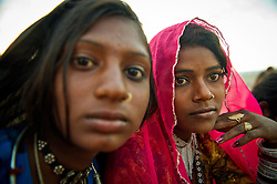Sunita Devi, 13, left and Subita Devi, 13 wake up and prepares tea at the world's largest annual cattle fair in the desert town of Pushkar, in the Indian state of Rajasthan. Every year thousands of camel herders from the semi-nomadic Rabari tribe, who make a living rearing animals, travel for two to three weeks across 500 kilometers to set up camp in the desert dunes near Pushkar to sell their livestock. The herders sell more than 20,000 camels, horses and other animals at the annual cattle fair.