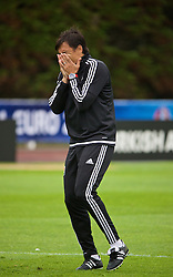 DINARD, FRANCE - Tuesday, July 5, 2016: Wales' manager Chris Coleman laughs with his staff during a training session at their base in Dinard as they prepare for the Semi-Final match against Portugal during the UEFA Euro 2016 Championship. (Pic by David Rawcliffe/Propaganda)