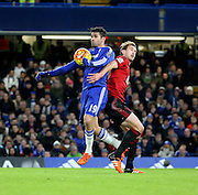 Chelsea striker Diego Costa shielding the ball from West Brom defender Gareth McAuley during the Barclays Premier League match between Chelsea and West Bromwich Albion at Stamford Bridge, London, England on 13 January 2016. Photo by Matthew Redman.