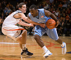 North Carolina guard Ty Lawson (5) is guarded by Virginia guard Sammy Zeglinski (13).  The the #5 ranked North Carolina Tar Heels defeated the Virginia Cavaliers 83-61 in NCAA Basketball at the John Paul Jones Arena on the Grounds of the University of Virginia in Charlottesville, VA on January 15, 2009.