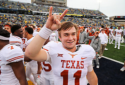 Nov 18, 2017; Morgantown, WV, USA; Texas Longhorns quarterback Sam Ehlinger (11) celebrates after beating the West Virginia Mountaineers at Milan Puskar Stadium. Mandatory Credit: Ben Queen-USA TODAY Sports