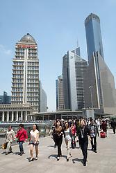 Busy pedestrian walkway in Lujiazui financial district in Pudong Shanghai China