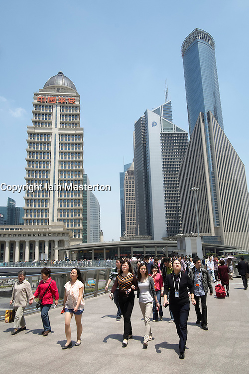 Busy pedestrian walkway in Lujiazui financial district in Pudong Shanghai China