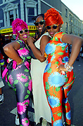 Three very colourful women at Notting Hill carnival. London, UK 2000's