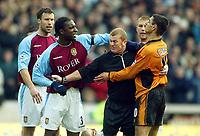 Photo: Scott Heavey.<br /> Wolverhampton Wanderers v Aston Villa. FA Barclaycard Premiership. 14/03/2004.<br /> Paul Durkin gets caught up in a brawl between JLloyd Samuel (L) and Vio Ganea