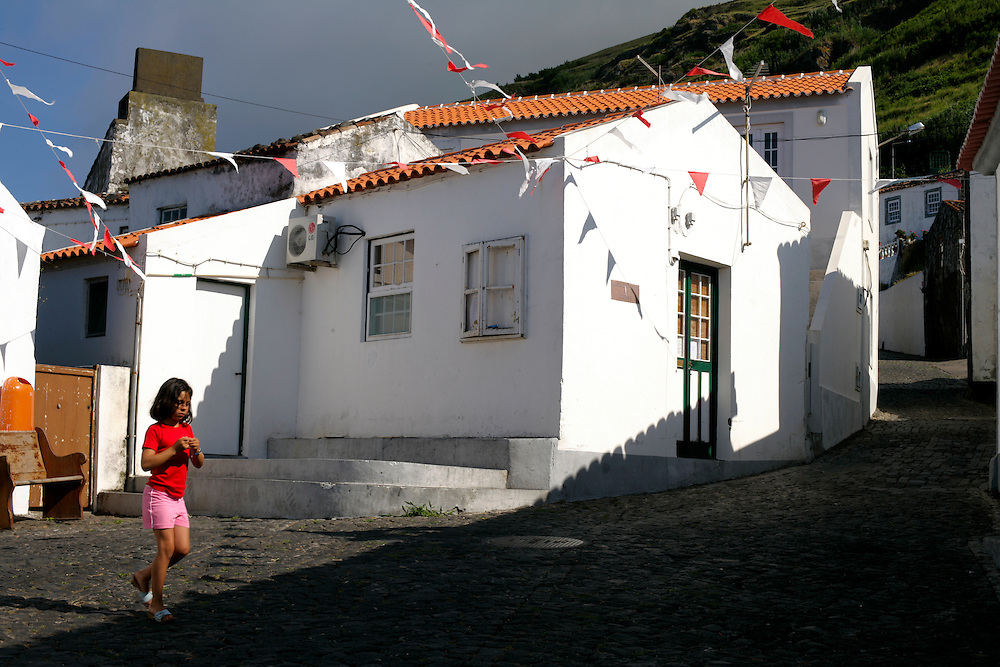 A girl passing in a street at Vila do Corvo, the smallest municipality in Portugal.