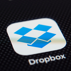 Dropbox online cloud storage app close up on iPhone smart phone screen