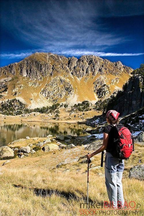 mountaineer woman. <br /> Colomers glaciar cirque. Aran Valley. Pyrenees mountain range. Lerida province.  Catalonia, Spain, Europe.