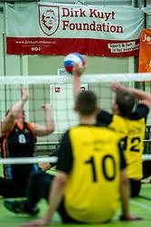 28-04-2018 NED: NK Zitvolleybal, Koog aan de Zaan<br /> vv Apollo Mill wint de kleine finale van het NK zitvolleybal met 3-2 van VC Allvo / banner Dirk Kuyt Foundation, item zitvolleybal