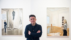 "© Licensed to London News Pictures. 28/11/2019. LONDON, UK. Polish artist Marcin Maciejowski poses with his works (L) ""It Certainly Has A Fairly Intriguing - Strange Composition"" and (R) ""It Is Enough I'm Delighted, Don't Make Me Understand It"", both 2019.  First look of ""Private View"" by Marcin Maciejowski at Galerie Thaddeus Ropac in Mayfair.  The artist's first London exhibition features new large-scale paintings and graphic works on paper merging comic-book and Old Master traditions.  The show runs 28 November to 25 January 2020. Photo credit: Stephen Chung/LNP"