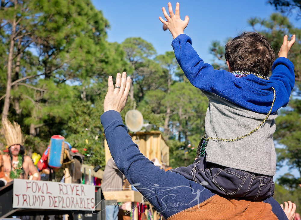 Mardi Gras fans wave at a float by the Fowl River Trump Deplorables as they ride down Bienville Boulevard in Dauphin Island's first People's Parade during Mardi Gras, Feb. 4, 2017, in Dauphin Island, Alabama. French settlers held the first Mardi Gras in 1703, making Mobile's celebration the oldest Mardi Gras in the United States. The first parade of the season is traditionally held on Dauphin Island and draws thousands. (Photo by Carmen K. Sisson/Cloudybright)