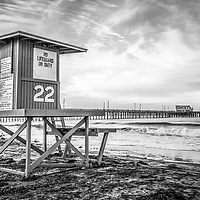 Photo of Newport Beach lifeguard tower 22 and Newport Pier in black and white. Newport Pier is located on Balboa Peninsula in Orange County Southern California along the Pacific Ocean. Photo is high resolution HDR style. For my full portfolio visit http://www.velgos.com