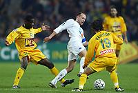 FOOTBALL - LEAGUE CUP 2003/04 - 03/02/2004 - 1/2 FINAL - FC NANTES v AJ AUXERRE - YANN LACHUER (AUX) / EMERSE FAE / MARAMA VAHIRUA (NAN) - PHOTO PIERRE MINIER / FLASH PRESS<br />  *** Local Caption *** 40001029