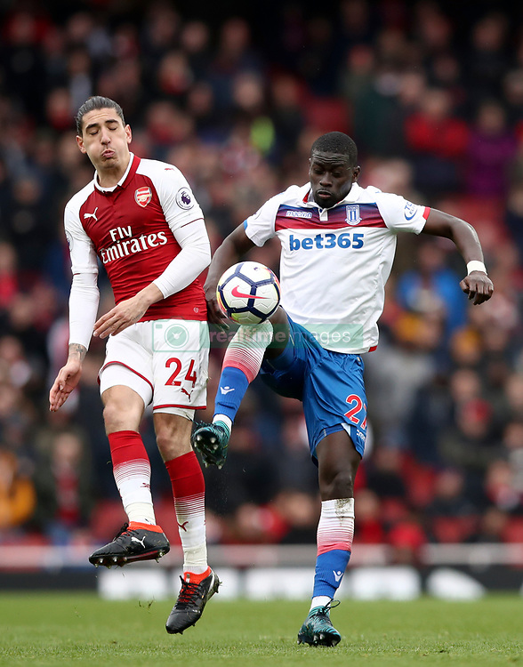 Arsenal's Hector Bellerin (left) and Stoke City's Badou Ndiaye battle for the ball during the Premier League match at The Emirates Stadium, London.