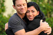 Homeowner Gwen Morales gives host Brandon Johnson after being mazed at the mini golf course and herb garden that was put in to fix the terracing and erosion on the side of the Morales house. As seen on HGTV's My House Goes Disney.