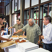 Student; Victor Molina Geting Pizza, 40 year counselor, serving Pizza to students at Event