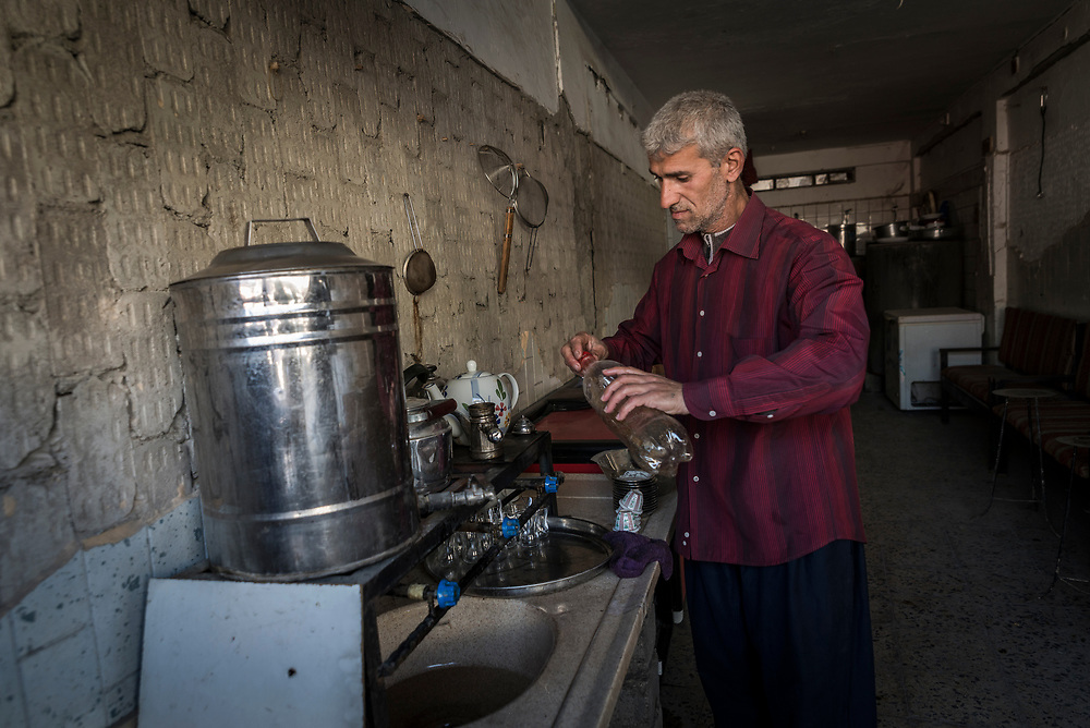 Father of six Radwan, 42, recently reopened his tea shop near the Grand Mosque of Al-Nuri in Mosul's historic centre. <br />