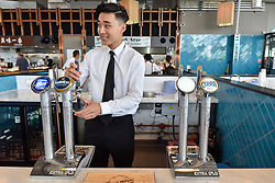 © Licensed to London News Pictures. 10/07/2017. London, UK. A barman pours drinks as Bang Bang Oriental Foodhall celebrates its grand opening in Colindale, north London.  Standing on the site of the former Oriental City, Bang Bang Oriental Foodhall brings stalls offering 27 different Asian cuisines and has modelled on the format of popular food courts in Asia. Photo credit : Stephen Chung/LNP