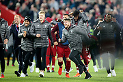It's all over and the bench charge on to celebrate with their teamates after the 4-0 win in the Champions League semi-final, leg 2 of 2 match between Liverpool and Barcelona at Anfield, Liverpool, England on 7 May 2019.