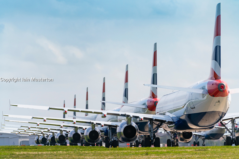 Many out of service grounded British Airways passenger aircraft during coronavirus lockdown at Glasgow Airport, Scotland, UK