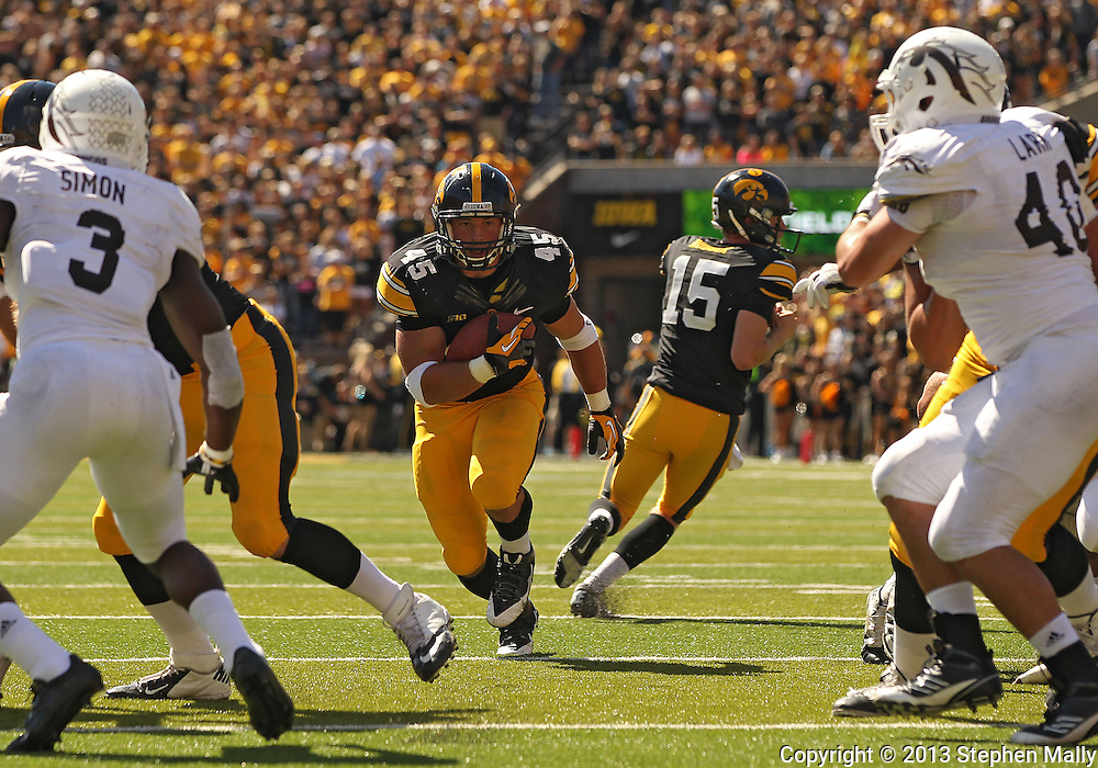September 21 2013: Iowa Hawkeyes fullback Mark Weisman (45) runs through a hole during the second quarter of the NCAA football game between the Western Michigan Broncos and the Iowa Hawkeyes at Kinnick Stadium in Iowa City, Iowa on September 21, 2013. Iowa defeated Western Michigan 59-3.
