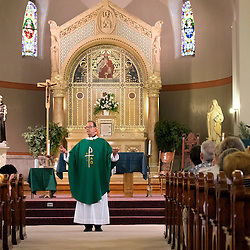 2 AUG. 2015 -- ST. LOUIS -- Father Tim Cook, pastor at Sts. Teresa and Bridget Catholic Parish in St. Louis, delivers his Homily during Mass Mob III Sunday, Aug. 2, 2015. The event brings Catholics from across the Archdiocese of St. Louis to worship at historic, urban parishes.<br /> <br /> Photo by Sid Hastings.