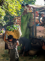 BAGAN, MYANMAR - CIRCA DECEMBER 2013: Man carrying vegetables in the Nyaung U market close to Bagan in Myanmar