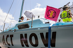 London, UK. 16 July, 2019. The Polly Higgins, a vessel named by climate activists from Extinction Rebellion after the noted eco-lawyer who campaigned for ecocide to be made a crime, is parked close to the camp on Waterloo Millennium Green on the second day of their 'Summer uprising', a series of events intended to apply pressure on local and central government to address the climate and biodiversity crisis. Credit: Mark Kerrison/Alamy Live News