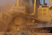 HEAVY EQUIPMENT WORKING TO BUILD A POND ON A TEXAS RANCH