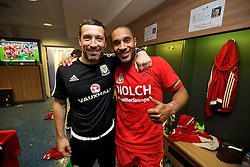 CARDIFF, WALES - Tuesday, October 13, 2015: Wales' head of fitness and science Ryland Morgans and captain Ashley Williams celebrate in the dressing room after the 2-0 victory over Andorra, and qualification for the finals, following the UEFA Euro 2016 qualifying Group B match at the Cardiff City Stadium. (Pic by David Rawcliffe/Propaganda)