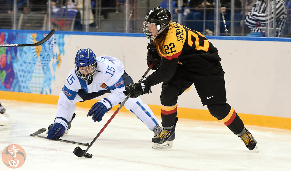 Feb 16, 2014; Sochi, RUSSIA; Germany forward Kerstin Spielberger (22) controls the puck past Finland forward Minttu Tuominen (15) in the women's ice hockey classifications round during the Sochi 2014 Olympic Winter Games at Shayba Arena.