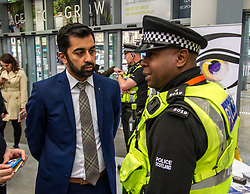 Pictured: Mr Yousaf ands Prince Durant, British Transport Police<br /> Humza Yousaf, MSP, minister for Transport and the Islands joined the Edinburgh Community Safety Partnership as they officially launched Edinburgh's Transport Charter aimed at eradicating hate crime on all forms of transport in the city. Each of the organisations involved with the partnership will outline their approach to responding to incidents.  The launch will be followed by two days of action where representatives will be in transport hubs, promoting an understanding of hate crime, raising awareness of the charter and how to report unacceptable behaviours. Charter Representatives: Transport and Environment Convener, Lesley Macinnes, Alex Hynes from the Scotrail Alliance, Michael Powell from Edinburgh Trams, Jason Hackett from First Buses, Superintendent Richard Horan from Police Scotland, Chief Inspector Sue Maxwell from British Transport Police and Transport Scotland. Allister McKillop Vice Chair of Equality Transport Advisory Group (ETAG) and representatives from the Access Panel, Hollaback, SCOREScotland, NKS, Edinburgh Women's Interfaith Group and SESTran along with students from Currie High School<br /> <br /> Ger Harley | EEm 27 June  2017
