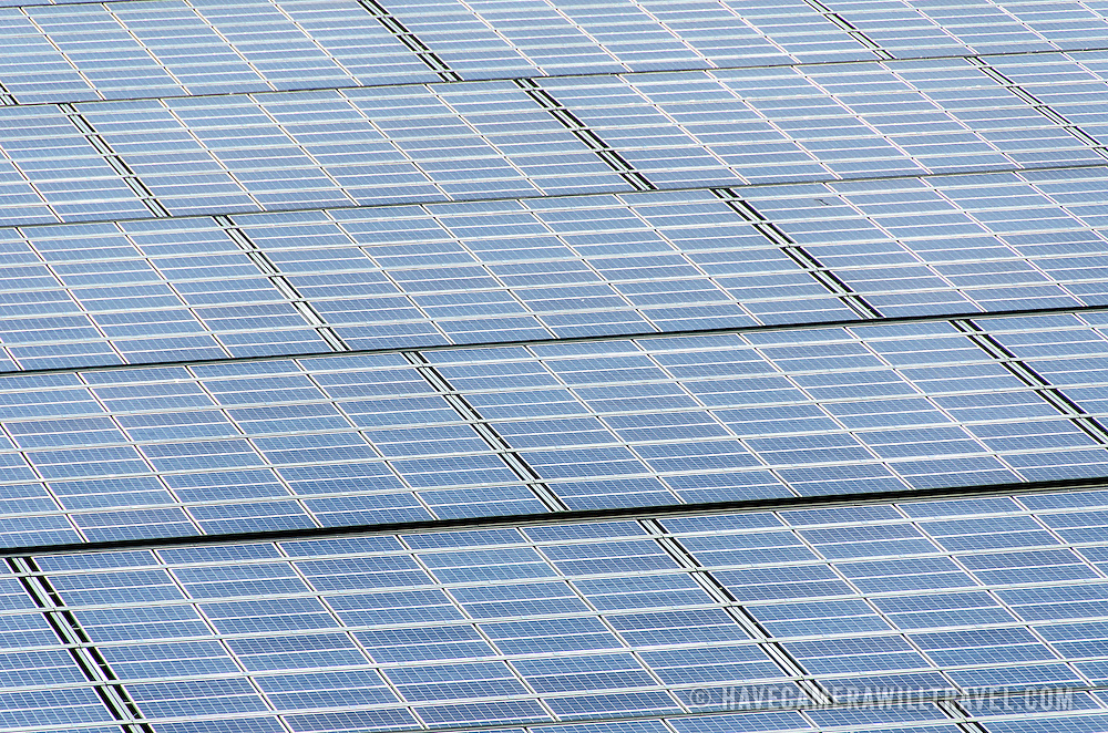 An array of solar photovoltaic panels used for converting sunlight into electrical energy in bright sunlight.