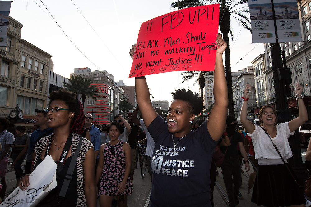 Protesters in New Orleans take to the streets of the French Quarter after a vigil for Michael Brown, part of a  protest in solidarity with the people of Ferguson Missouri for Michael Brown who was killed by police in Ferguson on August 9, 2014. The protest was one of many  held across the country.