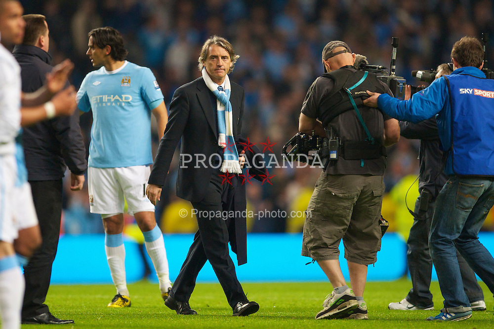 MANCHESTER, ENGLAND - Wednesday, May 5, 2010: Heaven knows he's miserable now... Manchester City's manager Roberto Mancini walks off dejected after his side lose 1-0 to Tottenham Hotspur and fail to qualify for the UEFA Champions League during the Premiership match at City of Manchester Stadium. (Photo by David Rawcliffe/Propaganda)