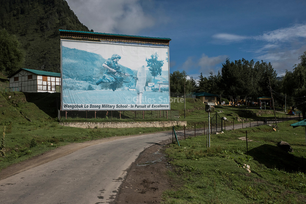 For a story by Steven Lee Myers, Bhutan<br /> Haa, Bhutan, August 3rd, 2017<br /> A billboard for a Bhutanese army military school in Haa, the nearest town before the Dokla ridge a disputed border area between Bhutan and China, at the center of heated tension between the latter and India. <br /> Gilles Sabri&eacute; pour The New York Times